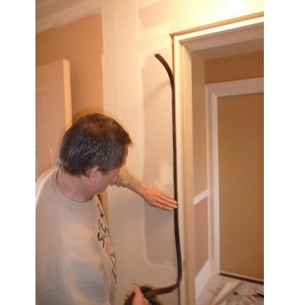 Apply Soundproofing Rubber below the molding surrounding the door frame to soundproof